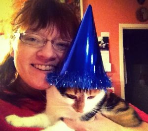 Me and the Bird on New Year's Eve. She was having a rough night. That hat did not help.