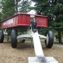 Giant Red Wagon, Spokane, WA with Jackie. Me discovering that the slide may not be built for my butt width. 2012